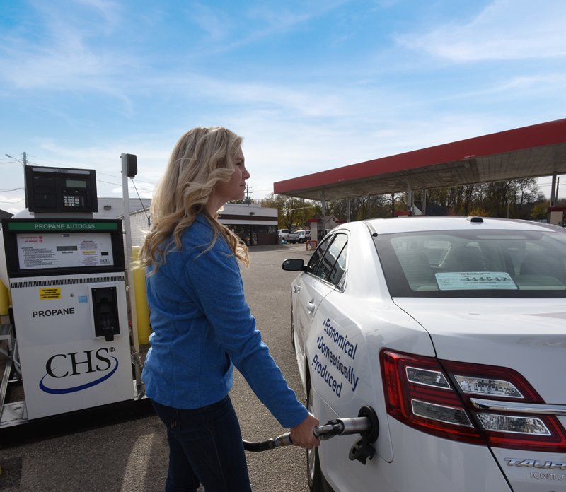 woman filling propane-powered vehicle